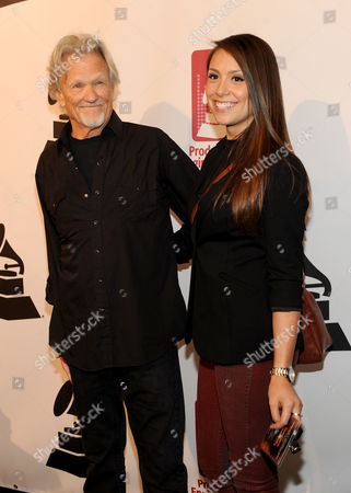 From left, Kris Kristofferson and Samantha Schultz arrive at the Producers and Engineers of The Academy's 7th Annual Grammy Week Event, at The Village Recording Studios, on in West Los Angeles, Calif