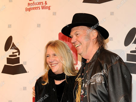 Honoree Neil Young, right, and Pegi Young arrive at the Producers and Engineers of The Academy's 7th Annual Grammy Week Event, at The Village Recording Studios, on in West Los Angeles, Calif