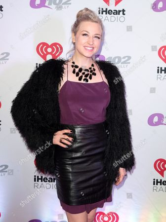 Bethany Watson poses for photographers backstage during the Q102 Jingle Ball at the Wells Fargo Center, in Philadelphia