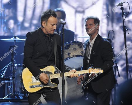 Bruce Springsteen and Garry Tallent perform at the 2014 Rock and Roll Hall of Fame Induction Ceremony on Thursday, April, 10, 2014 in New York