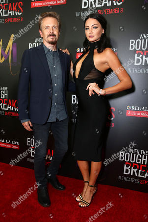 "Stock Photo of John Frizzell, left, and Anna Sizykh attend the Screen Gems premiere of ""When the Bough Breaks"" at Regal Cinemas L.A. Live, in Los Angeles"