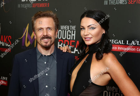 "John Frizzell, left, and Anna Sizykh attend the Screen Gems premiere of ""When the Bough Breaks"" at Regal Cinemas L.A. Live, in Los Angeles"