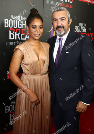 """Regina Hall, left, and Jon Cassar attend the Screen Gems premiere of """"When the Bough Breaks"""" at Regal Cinemas L.A. Live, in Los Angeles"""