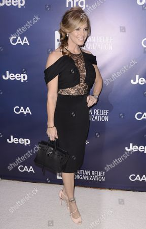 """Stock Image of Sandi Taylor arrives at the 4th annual Sean Penn and Friends """"Help Haiti Home"""" Gala at the Montage Hotel, in Beverly Hills, Calif"""