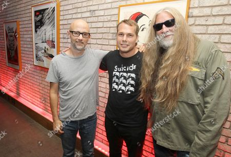 Stock Image of Musician Moby left, artist Shepard Fairey and Tommie Sunshine attend the Shepard Fairey: On Our Hands exhibition opening presented by Hennessy V.S. at the Dream Downtown, in New York