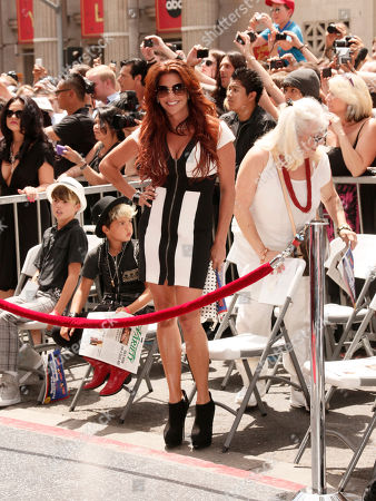 Perla Ferrar poses at the Hollywood Walk of Fame for Slash on in Los Angeles, CA