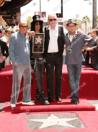 Stock Picture of Musician Slash honored with the 2,473rd Star on the Hollywood Walk of Fame with (L-R) Producer Robert Evans, DJ Jim Ladd, Actor Charlie Sheen, outside the Hard Rock Cafe on in Hollywood, California