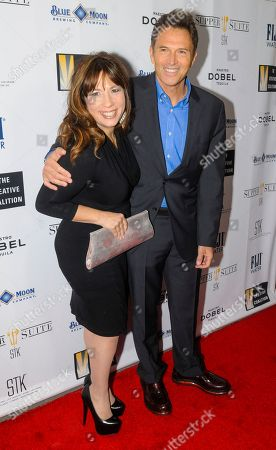 Robin Bronk, COE, The Creative Coalition, left, and actor Tim Daly, right, arrive at the 'Supper Suite by STK honors The Creative Coalitions Arts in America Benefit Gala' at STK DC on in Washington, D.C. The event is supported by STK DC, Fiji Water, Maestro Dobel Tequila and Blue Moon Brewing. The annual benefit aims to promote the continued support of arts in America by encouraging the entertainment and media industry to dialogue with Capitol Hill
