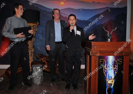 Stock Image of Chip Johannessen, and from left, Pete Hammond and Paul Greenberg attend the Television Academy's 66th Emmy Awards Writers Nominee Reception on at the Television Academy in the NoHo Arts District of Los Angeles