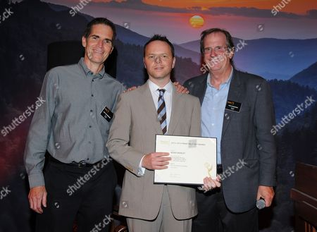 Chip Johannessen, and from left, Noah Hawley and Pete Hammond attend the Television Academy's 66th Emmy Awards Writers Nominee Reception on at the Television Academy in the NoHo Arts District of Los Angeles