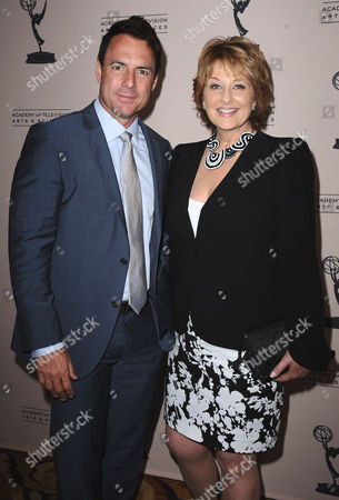 Mark Steines and Cristina Ferrare arrive at the 40th Annual Daytime Emmy Awards nominee reception at the Montage Beverly Hills on in Beverly Hills, Calif