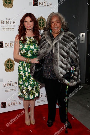 Producer and Actress Roma Downey and Della Reese pose on the red carpet at the celebration of the April 2 Blu-ray, DVD, and Digital HD release of THE BIBLE from Twentieth Century Fox Home Entertainment during The Bible Experience opening night gala, a rare exhibit of biblical artifacts, in New York City on Tuesday, March 19 in New York