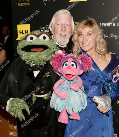 Caroll Spinney, left, and Leslie Carrara Rudolph pose with puppets Oscar the Grouch, left, and Abby Cadabby at the 39th Annual Daytime Emmy Awards at the Beverly Hilton Hotel on in Beverly Hills, Calif