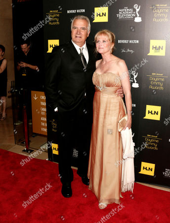 Stock Image of John McCook, left, and Laurette Spang arrive at the 39th Annual Daytime Emmy Awards on HLN at the Beverly Hilton Hotel on in Beverly Hills, Calif