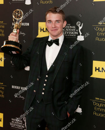 """Chandler Massey poses backstage with the award for outstanding younger actor in a drama series for """"Days of our Lives"""" at the 39th Annual Daytime Emmy Awards at the Beverly Hilton Hotel on in Beverly Hills, Calif"""