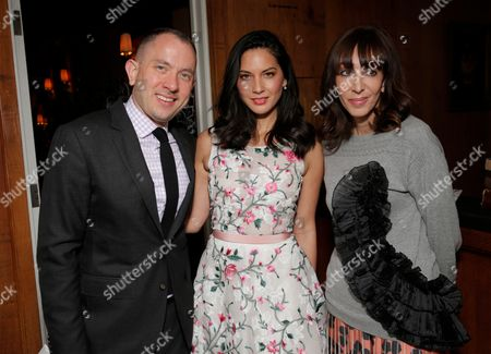 From left, Jonathan Aubry, Olivia Munn and Merle Ginsberg attend The Hollywood Reporter & Jimmy Choo Celebration of the Most Powerful Stylists in Hollywood,, in West Hollywood, Calif