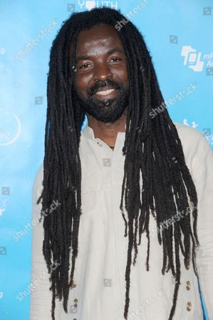 Rocky Dawuni arrives at the launch of the mPowering Action platform at The Conga Room at L.A. LIVE on in Los Angeles