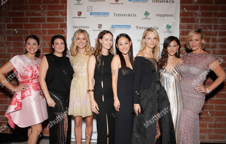 Event chairs Sabina Nathanson, and from left, Yifat Oren, Jackie Winnick, Jenni Kayne, Mira Lee, Kelly Sawyer Patricof, Norah Weinstein and Ali Taekman attend the Third annual Baby2Baby Gala honoring Kate Hudson at The Book Bindery, in Culver City, Calif