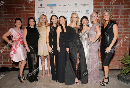 Event chairs Sabina Nathanson, and from left, Yifat Oren, Jackie Winnick, Jenni Kayne, Mira Lee, Kelly Sawyer Patricof, Norah Weinstein, Ali Taekman and Cristina Cheever attend the Third annual Baby2Baby Gala honoring Kate Hudson at The Book Bindery, in Culver City, Calif