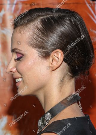 """Actress Katherine DuBois (hair detail) arrives at the west coast special screening of """"CBGB"""" at ArcLight Hollywood on in Los Angeles"""