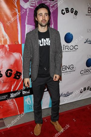 """Stock Photo of Actor Josh Zuckerman arrives at the west coast special screening of """"CBGB"""" at ArcLight Hollywood on in Los Angeles"""