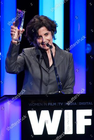 Producer Lianne Halfon accepts the Crystal Award for Excellence in Film at the Women in Film 2016 Crystal + Lucy Awards at the Beverly Hilton, in Beverly Hills, Calif