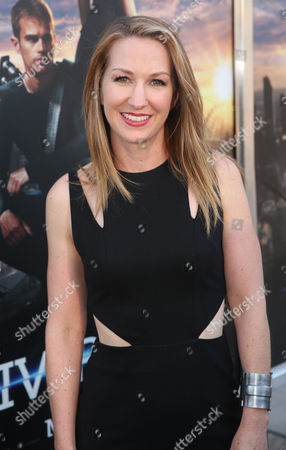 """Screenwriter Vanessa Taylor arrives at the world premiere of """"Divergent"""" at the Regency Bruin Theatre on in Los Angeles"""
