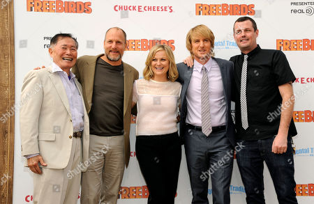 """Jimmy Hayward, far right, writer and director of """"Free Birds,"""" poses with cast members, left to right, George Takei, Woody Harrelson, Amy Poehler and Owen Wilson at the world premiere of the film at the Regency Village Theater, in Los Angeles"""
