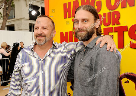 "Stock Picture of Executive producer Aron Warner, left, and screenwriter/producer Scott Mosier pose together at the world premiere of ""Free Birds"" at the Regency Village Theater on in Los Angeles"