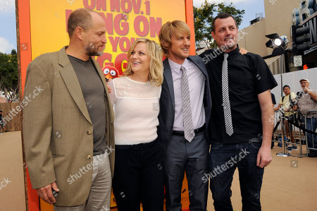 """Jimmy Hayward, far right, writer/director of """"Free Birds,"""" poses with cast members, left to right, Woody Harrelson, Amy Poehler and Owen Wilson at the world premiere of the film at the Regency Village Theater on in Los Angeles"""