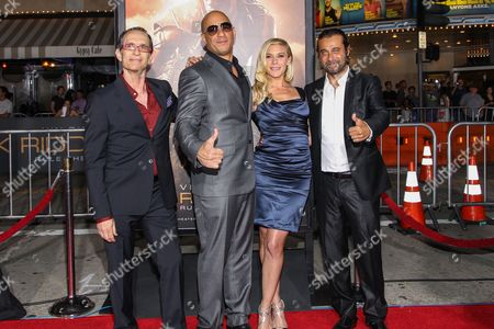 """From left, writer/director David Twohy, actors Vin Diesel, Katee Sackhoff and Jordi Molla arrive at the world premiere of """"Riddick"""" at the Mann Village Westwood Theater on in Los Angeles"""
