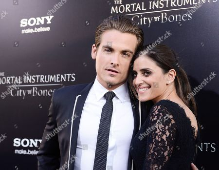 """Actor Kevin Zegers, left, and his wife, actress Jaime Feld arrive at the world premiere of """"The Mortal Instruments: City of Bones"""" at the ArcLight Cinerama Dome on in Los Angeles"""