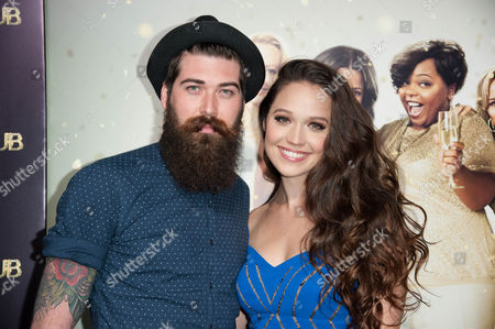 """Toran Caudel, left, and Jaclyn Betham arrive at the world premiere of """"The Single Moms Club"""", in Los Angeles"""