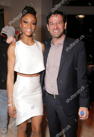 Lifetime EVP and GM Rob Sharenow and Yaya DaCosta attend the Premiere of Lifetime's Whitney at the Paley Center on in Beverly Hills, Calif