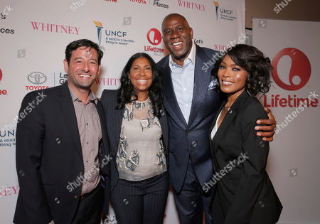 From left, Lifetime EVP and GM Rob Sharenow, Cookie Johnson, Magic Johnson and Director Angela Bassett attend the Premiere of Lifetime's Whitney at the Paley Center on in Beverly Hills, Calif