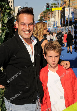 """Adrian Pasdar and guest arrive at the world premiere of """"Monsters University"""" at the El Capitan Theatre, in Los Angeles"""