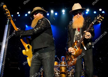 ZZ Top, left to right, Dusty Hill, Frank Beard and Billy Gibbons perform at Blue Hills Bank Pavilion, in Boston