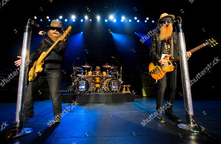 Dusty Hill, from left, Frank Beard and Billy Gibbons of ZZ Top perform at Blue Hills Bank Pavilion, in Boston