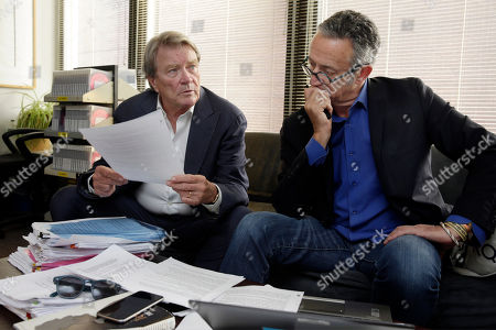 """60 Minutes"""" correspondent Steve Kroft, left, and producer Michael Gavshon, go over a script as they edit a segment for an upcoming show, in the """"60 Minutes"""" offices, in New York"""