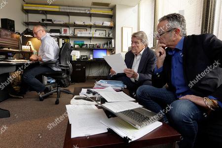 "Steve Kroft, Michael Gavshon, Daniel J. Glucksman. 60 Minutes"" correspondent Steve Kroft, center, producer Michael Gavshon, right, and editor Daniel J. Glucksman, go over a script as they edit a segment for an upcoming show, in the ""60 Minutes"" offices, in New York"