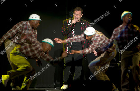 """Saturday, July 2017, South African musician Johnny Clegg, middle, and the dancers perform during """"The Final Journey"""" concert at the Grand Arena in Cape Town, South Africa. Clegg, who has had chemotherapy and other treatment for pancreatic cancer, says he feels """"fit and strong"""" as he begins his last international tour"""