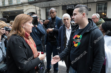 Grenfell resident Paul Menacar (R) asks local MP Emma Dent Coad why she hasn't visited him as they stand outside The Connaught Rooms on the first day of the public inquiry into the Grenfell fire