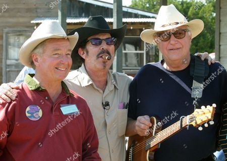 WALKER. Texas gubernatorial candidate Kinky Friedman, center, poses with attorney Dick DeGuerin, left, and country singer Jerry Jeff Walker at a campaign fundraiser at Willie Nelson's ranch outside Austin, Texas. Walker has donated his music archives to The Wittliff Collections at Texas State University. The school in San Marcos, announced the acquisition from the 75-year-old Walker, who in the 1960s emerged from New York's Greenwich Village folk scene