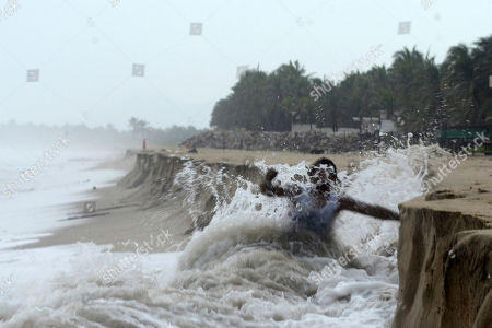 A man fights against waves caused by approaching Hurricane Max that took away part of the beach in Pie de La Cuesta, on the outskirts of Acapulco, Guerrero state, . Max has strengthened into a Category 1 hurricane off Mexico's southern Pacific coast and is forecast to make landfall later Thursday along the coast of Guerrero state. It's a region that includes the resort city of Acapulco