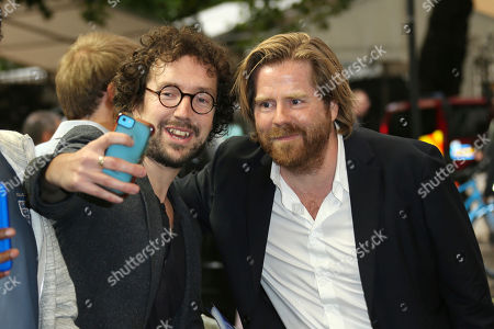 Director Janus Metz poses for a photograph with a fan upon arrival at the premiere of the film 'Borg Vs McEnroe' in London