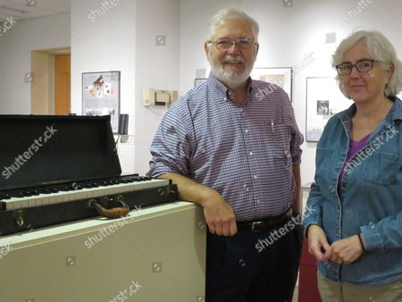 University of New Hampshire Special Collections Librarian Bill Ross, left, and museum curator Dale Valena stand next to a practice keyboard once owned by composer Amy Beach in Durham, NH. The university is celebrating the pioneering composer's 150th birthday with an academic conference, musical performances and an exhibit of Beach memorabilia