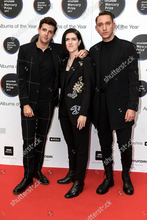 Jamie Smith, Romy Madley Croft, Oliver Sim. Musicians from left, Jamie Smith, Romy Madley Croft, and Oliver Sim of the group 'The XX' pose for photographers on arrival at the Mercury Prize 2017 awards, in London, Thursday, Sept.14, 2017
