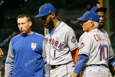 Brian Chicklo, Amed Rosario, Terry Collins. New York Mets' assistant trainer Brian Chicklo, left, and manager Terry Collins (10) pull Amed Rosario from the game in the middle of the fifth inning of a baseball game against the Chicago Cubs, in Chicago