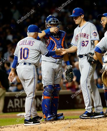 Seth Lugo, Terry Collins, Travis d'Arnaud. New York Mets manager Terry Collins (10) pulls starting pitcher Seth Lugo as catcher Travis d'Arnaud watches during the fourth inning of a baseball game against the Chicago Cubs, in Chicago