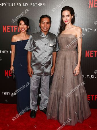 """Loung Ung, Kompheak Phoeung, Angelina Jolie. Loung Ung, from left, Kompheak Phoeung and Angelina Jolie attends a special screening of Netflix's""""First They Killed My Father"""" at the DGA theater, in New York"""